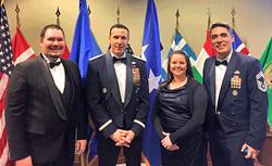 (l to r), Josh Barrett, Chievres Branch Manager,  Lt. Gen. Steven M. Shepro, Britney Gardner, Head Teller and CMSgt Alfred Coe.