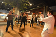 The over 21 crowd took time out from adult beverages, food, and playing for a Tai Chi lesson in Take Me There China