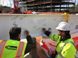 Team signs final beam for topping out ceremony