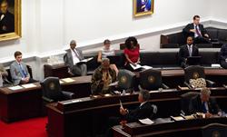 State representative delivering statement celebrating 125th anniversary of The University of North Carolina at Greensboro