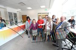 SLCC President Deneece G. Huftalin cuts a DNA 'ribbon' to open the new Dumke Center for STEM Learning.