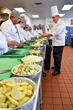 Chef James Cwynar, Director, instructs students the finer points of making ratatouille in the training kitchen of The Culinary School at Eva's Village, in Paterson, NJ.