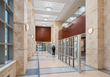 The main entrance lobby was designed with stone tile for elegance and durability.