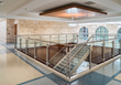 The main stairway of the new justice building was designed with marble and wooden accents.