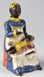 Kyser & Rex Cast Iron Mammy & Child Mechanical Bank, Estimated at $3,000-7,000.