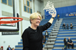 Salt Lake Community College women's basketball Head Coach Betsy Specketer, Region 18 Coach of the Year, celebrates her team's Region 18 victory.