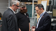 Tom Rosenberg, VP of Engineering (left) and Craig Simmons, Level II Machine Operator (center) discuss with Governor  Matt Bevin the importance of manufacturing and vocational education.