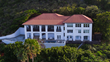 Hawk's Nest is a Caribbean-style villa convenient to the main resort area, Deadman's Beach and mega-yacht harbor.