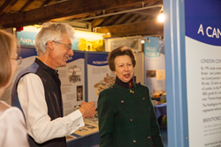 HRH The Princess Royal talking to Charlie Forman of the London Canal Museum
