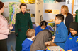 HRH The Princess Royal watching children undertaking a bridge building activity at the London Canal Museum
