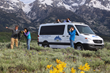 Guests of Wildlife Expeditions Spring Wolves & Bears trips enjoy traveling through Yellowstone National Park in custom Mercedes-Benz Sprinter vans, supplied with high-power binoculars for wildlife vie