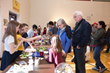 Visitors observe one of the many science projects the school's fourth through eighth grade students presented at the recent St. Paul Lutheran STEM Night.