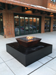 A firepit and fountain designed by Metaphor with Designboard.