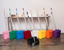 Remco's set of color-coded lobby dustpans and brooms
