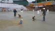 PENETRON goes to work: After an initial dry shake application, PENETRON PLUS will give greater impact and abrasion resistance to the concrete substrate at An Binh City, Hanoi.