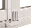 Safety latches on windows and doors, like this patio door foot lock, is another way to safeguard children and pets.