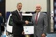 David Schutt, SAE International CEO, and Ken Kelzer, General Motors vice president of Global Vehicle Components and Subsystems.