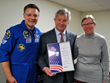 Pictured: Yuri Gerasimov and his wife Nina, along with NASA Astronaut Colonel Douglas Wheelock