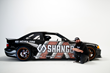 FORMULA DRIFT driver Danny George poses with his Shango-branded BMW M3