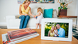 PhotoSpring digital photo frame shown on living room coffee table