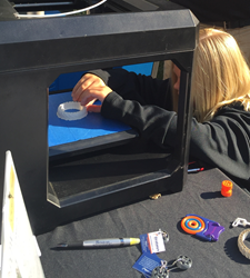 Natalie, 6th Grade student at Waconia Clearwater Schools in Minnesota, uses a Makerbot 3D Printer to print a bracelet