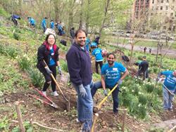Members of Team CheapOair clean Morningside Park in Harlem