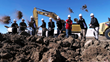 Key members of the RUPES USA management team toss the first few shovels of earth on what will be the new US headquarters