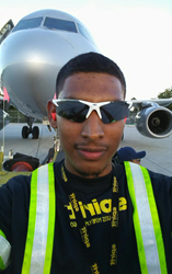 Emil Rodriguez standing in front of an airplane