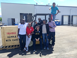 Refugees who have gone through the warehouse and distribution training program at the Utah Refugee Education and Training Center.