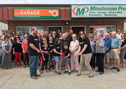 Dee Bisel and her team celebrate their new location in Lawrence, KS. The new facility includes The Garage, a free community meeting space. Learn more about Minuteman Press franchise opportunities at http://www.minutemanpressfranchise.com