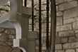 Spiral Staircase Crafted of Indiana Limestone Highlights Michigan Home Makeover