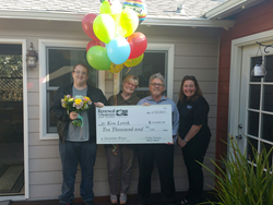 Renewal by Andersen of San Francisco replacement windows and patio doors presents check to winners