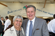 Eva Hernandez, S.M.I.C.  with Board President Mark Schmit. In 1982, she was the first Kitchen Director, and is the namesake of Eva's Village.