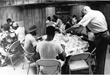 Msgr. Puma serving guests at Eva's Kitchen in 1982, when it was the first soup kitchen in N. NJ to provide supportive services.