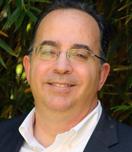 Karim Belhadjali, principal associate