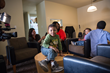 Jordan McCrackin, 3, plays in the living room of the family's new apartment
