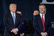 U.S. President Donald Trump stands with Liberty University President Jerry Falwell at Liberty's 44th Commencement.