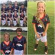 Mackayla on flag football team with all boys