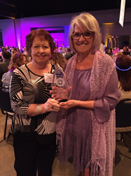 Pam Crawford (L) and Shirley Wood (R), the longest tenured employees of Balluff, accepted the award on behalf of the company.