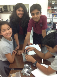 Stratford students working on an experiment