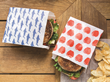 LunchSkins Recyclable + Resealable Paper Sandwich Bags blend convenience with sustainability.