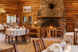 Delicious gourmet meals are part of the all-inclusive Brooks Lake Lodge & Spa experience and are served in the historic dining hall, which also boasts a Western art collection and stone fireplace.