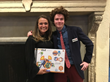 Ethan Wadsworth, YAA honoree, with Julie Blakeman, winner of a raffle for a set from Guidecraft featuring Ethan's characters and graphics