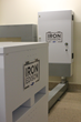 Pictured are two of the eight total Lithium Iron battery enclosures with the BMS panel in the background.