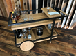 A bar cart crafted of Reclaimed Oak was shared by Zenbox Design at Pioneer Millworks Read:Grain DWP Open House.