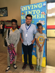 Clubhouse Director Roger Martinez (C) with contest winner Monica (R) and sister (L) at Montandon Boys & Girls Club