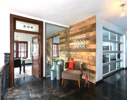 Interior shot of AtkinsParker Creative Agency shows historic wood detailing.