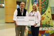 Pictured above, Chief of Pediatric Nephrology and Director of the Tuberous Sclerosis Center of Excellence John Bissler, MD and Ambulatory Care nurse Jayme Wasson accept a $30,000 donation from Bcurefu