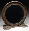Lot 1183: Tiffany Glass & Decorating Company peacock mirror, estimated at $2,500-3,500.