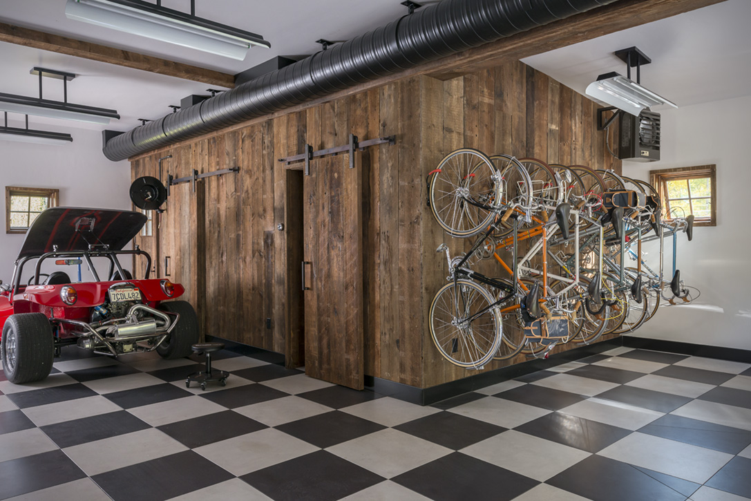The Ground Floor Garage Of Guest Barn Features A Graphic Checkerboard Tile And Customized Storage For Homeowners Vintage Cars Road
